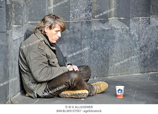 beggar near Cologne Cathedral, Germany, North Rhine-Westphalia, Koeln