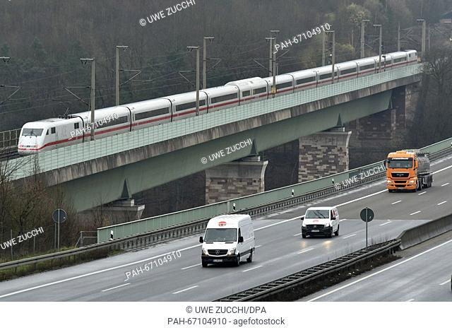 An ICEhigh-speed train rides over the Werra Bridge by the A7 highway between Kassel and Hanover near Hann. Muenden, Germany, 31 March 2016