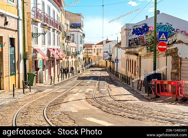 Tracks of the famous tramline twenty-eight in the Alfama district of Lisbon