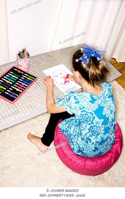 A girl drawing, Sweden