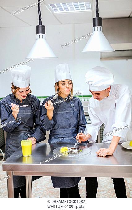 Junior chefs tasting a dessert