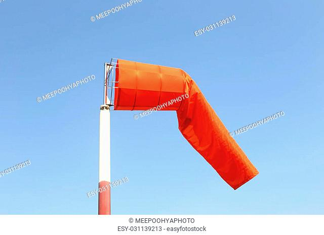 Wind sock of equipment check the wind blow direction in day time on blue sky background