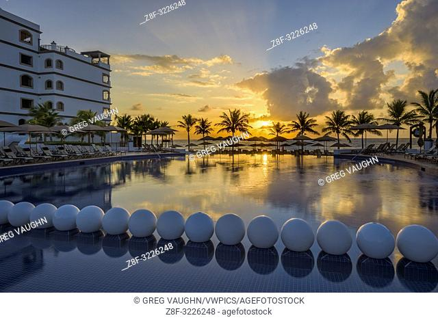 Swimming pool at sunrise, Grand Residences Riviera Cancun, Riviera Maya, Puerto Morelos, Quintana Roo, Yucatan Peninsula, Mexico