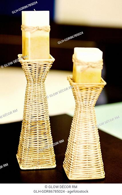 Candlestick holders with candles on a table