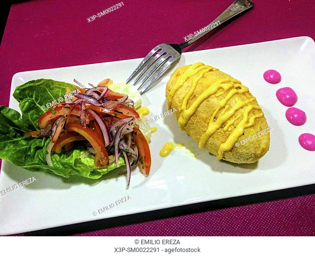 Filled potato and salad. Peruvian dish
