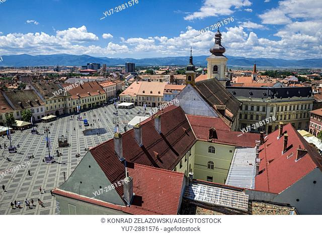 Aerial view from Council Tower on a historical buildings on Large Square of Historic Center of Sibiu city, Romania. Holy Trinity Church on photo
