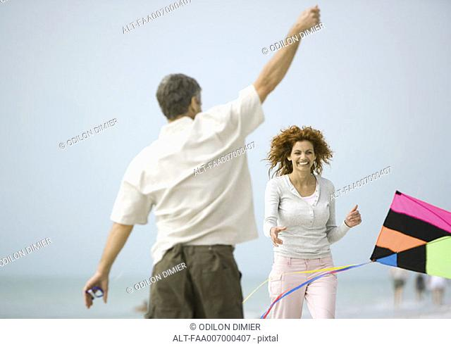 Couple with kite on beach