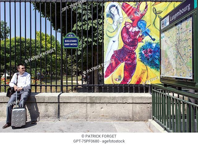 EXHIBITION ON THE FENCES OF THE LUXEMBOURG GARDENS IN FRONT OF THE METRO STATION EXIT, BOULEVARD SAINT-MICHEL, PARIS (75), FRANCE