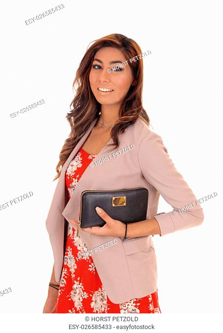 .Young lovely woman in a red dress and jacket holding her handbag, .standing isolated for white background.