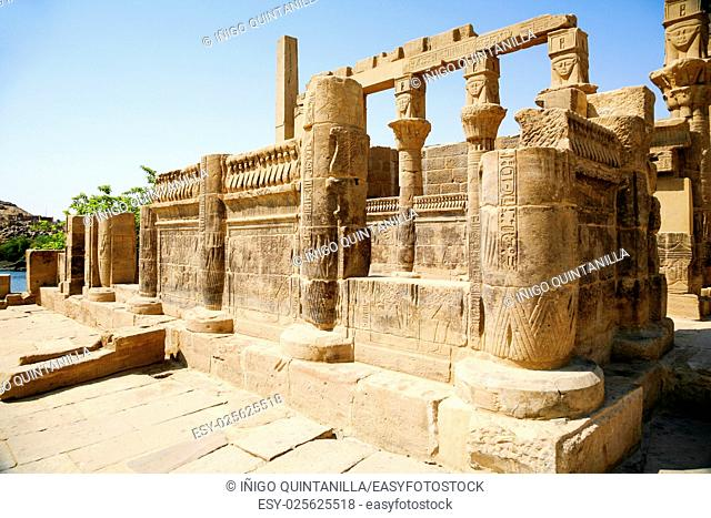 stone carved colonnade in landmark Philae Temple, Egyptian public monument for the goddess Isis, declared World Heritage Unesco, in Egypt, Africa
