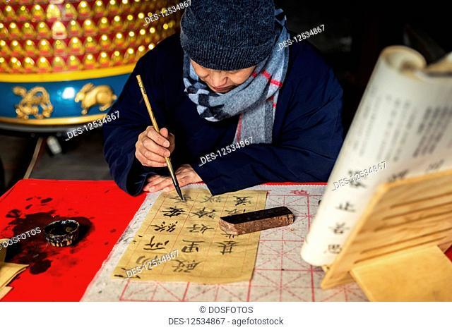 Monk practising calligraphy, White Cloud Temple; Beijing, China