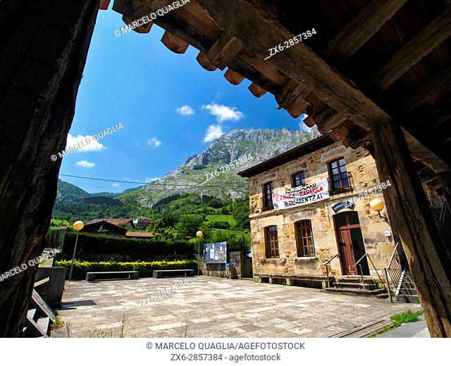 Arrazola village square and Anboto Peak at background. Urkiola Natural Park. Bizkaia province. Euskadi. Spain