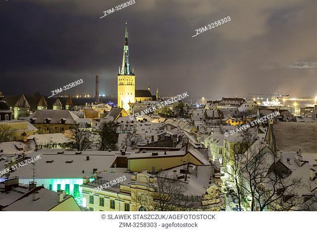 Winter evening in Tallinn old town, Estonia. St Olaf church dominates the skyline
