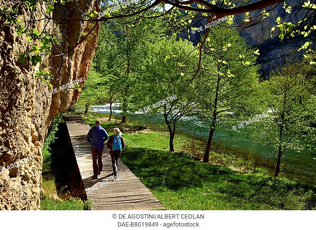 Two hikers on a path near Roski Slap, Krka National Park, Croatia