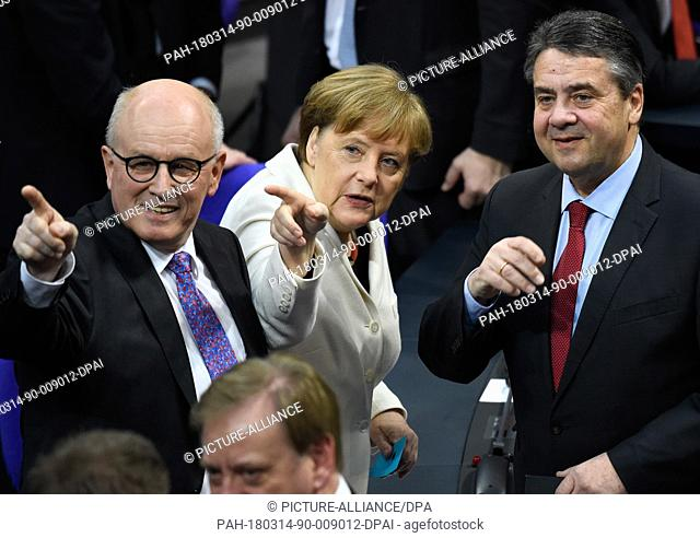 14 March 2018, Germany, Berlin: Volker Kauder, CDU/CSU parliamentary group leader, Chancellor Angela Merkel (both CDU) and outgoing foreign minister Sigmar...