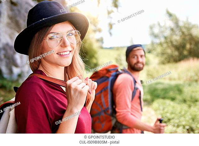 Portrait of woman hiking looking at camera smiling, Krakow, Malopolskie, Poland, Europe