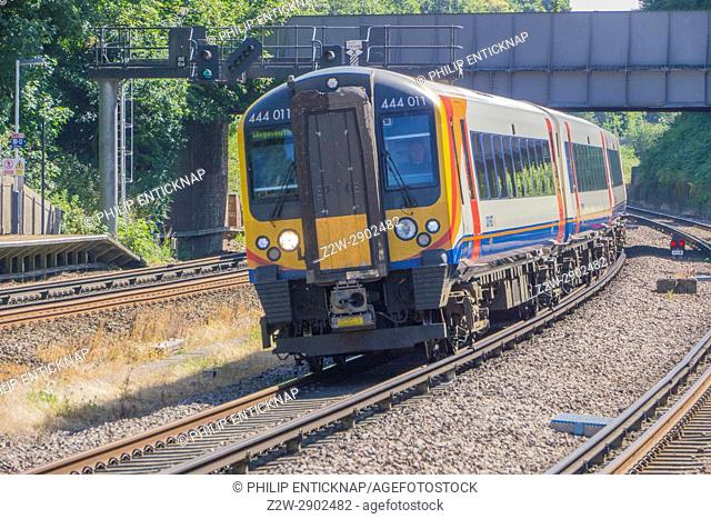 Class 444 EMU Desiro Electric Train of South West Trains passes throuh Farnborouh Station Hampshire on 5th July 2017