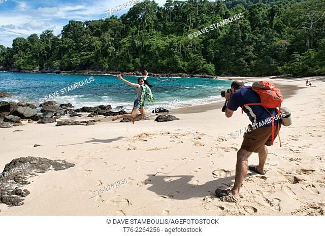 photographer and model, Teluk Hijau beach, Meru Betiri National Park, Java, Indonesia