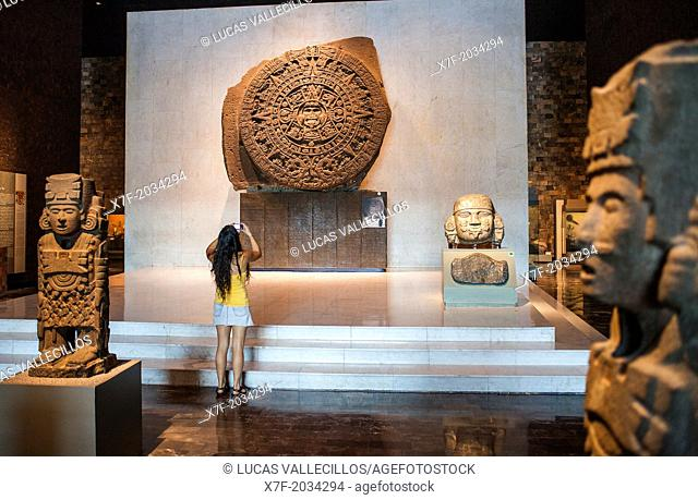 The Aztec Stone of the Sun and other artifacts on display at National Museum of Anthropology, Mexico City, Mexico