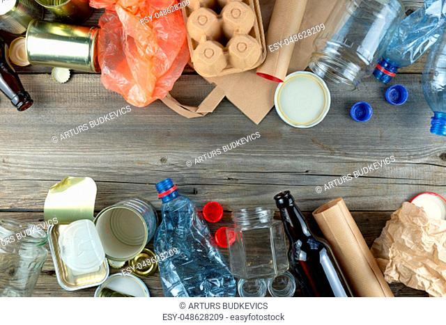 Plastic, glass, metal and paper garbage for recycling concept reuse and recycle. Copy space