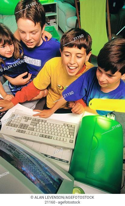 Children playing computer games on the internet