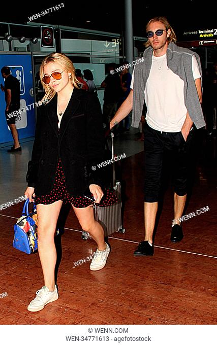 6ec9e982a4e Chloe Grace Moretz and her brother Trevor arrive at Charles de Gaulle  Airport Featuring  Chloë