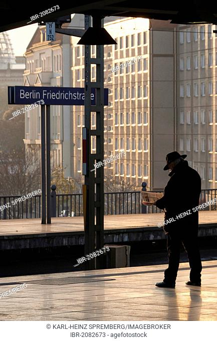 Man waiting on the platform of the Berlin S-Bahn station Bahnhof Friedrichstrasse, Berlin, Germany, Europe