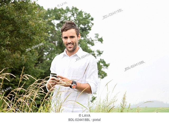 portrait of young man with mobile phone