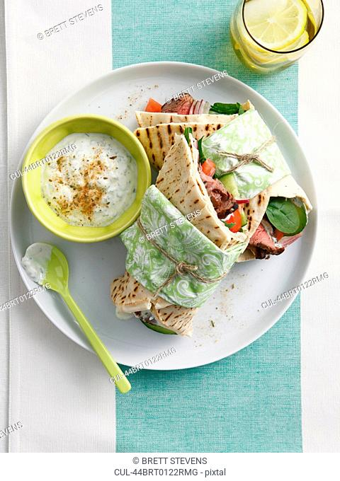 Plate of wrap with dipping sauce