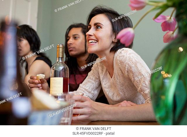 Woman talking at dinner table