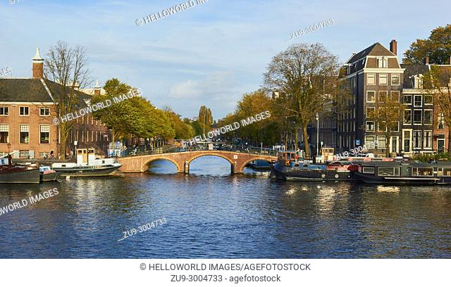 View across the Amstel river towards Dirk Van Nimwegenbrug bridge and Nieuwe Keizersgracht, Amsterdam, Netherlands