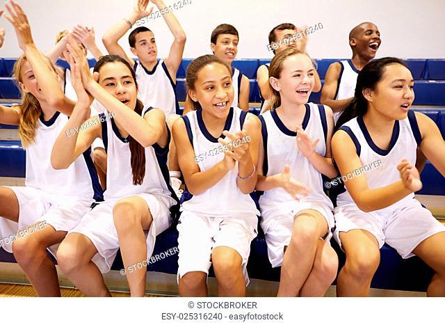 Spectators Watching High School Basketball Team Match