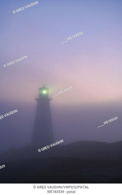 Cape Spear Lighthouse in early morning fog, St. John's, Newfoundland, Canada