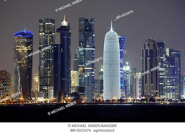 Skyline of Doha with Al Bidda Tower, Palm Tower 1 and 2, World Trade Center, Burj Qatar Tower with silver illumination, Tornado Tower, night scene
