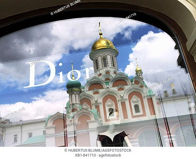 Main department store GUM, Glavnyi Universalnyi Magazin, reflection of the Kazan-Cathedral in the Dior window,  Moscow, Russia