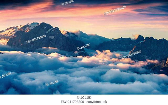 Foggy morning scene in the Val di Fassa valley. View from the bird's eye from Sella pass, Province of Bolzano - South Tyrol