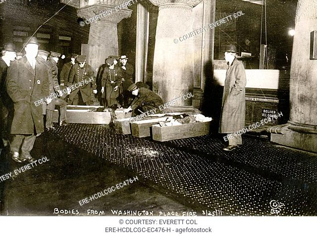 Bodies from Triangle Shirtwaist fire. City officials placing Triangle Shirtwaist Company fire victims in coffins. March 25, 1911