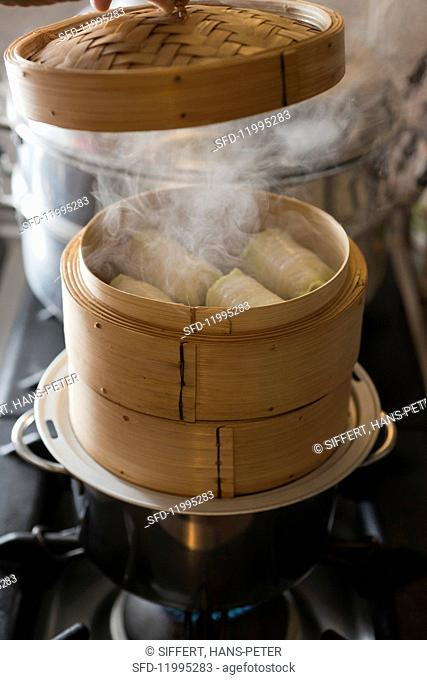 Chinese cabbage rolls in a steaming basket
