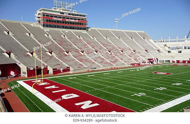 bleachers and field at Indiana University's Memorial Stadium in Bloomington, empty, construction crane visible at one end