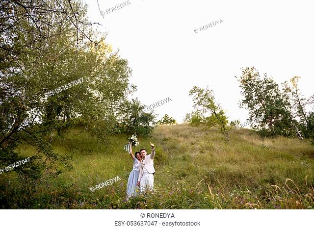 Young couple in love outdoor. Elegant bride and groom posing together outdoors on a wedding day. bride and groom in the Park