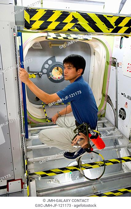 Japan Aerospace Exploration Agency astronaut Takuya Onishi participates in an emergency scenario training session in an International Space Station...