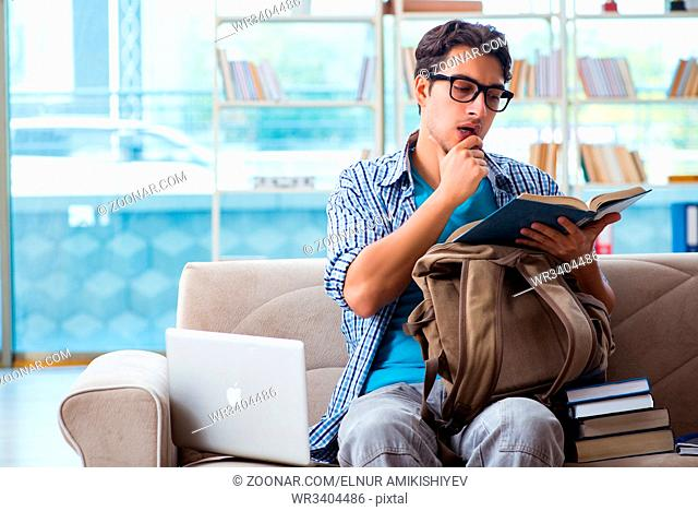 Caucasian student with laptop preparing for university exams