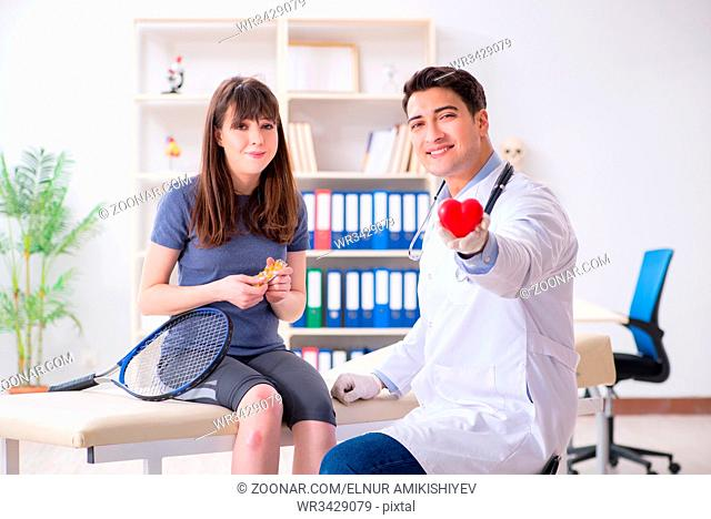 Female tennis player visiting male doctor for check-up
