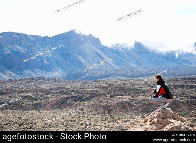 Hiker on viewpoint in Teide National Park, Tenerife, Balearic Islands, Spain