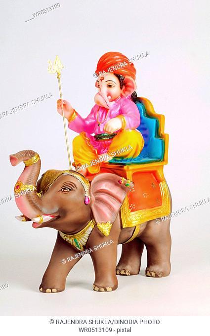 Statue of lord ganesh sitting on elephant , India