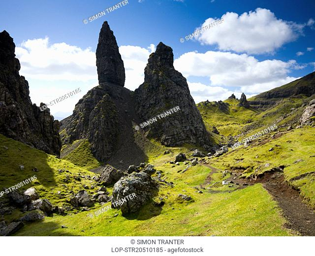 Scotland, Highland, Isle of Skye. The Old Man of Storr, an unusual rock formation formed by a prehistoric land slide and erosion, on the Trotternish peninsula