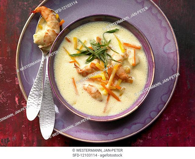 Ginger soup with prawns, carrots and pumpkin