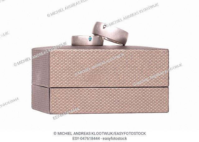 Wedding rings on a box, isolated on white background
