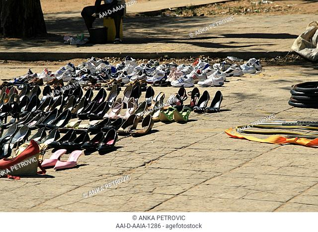 Street vendors selling women's shoes, Maputo, Mozambique