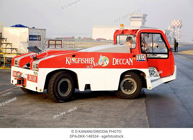 Push back vehicle of king fisher deccan ltd. at run way ; Chattrapati Shivaji Terminal ; Santacruz ; Bombay now Mumbai ; Maharashtra ; India